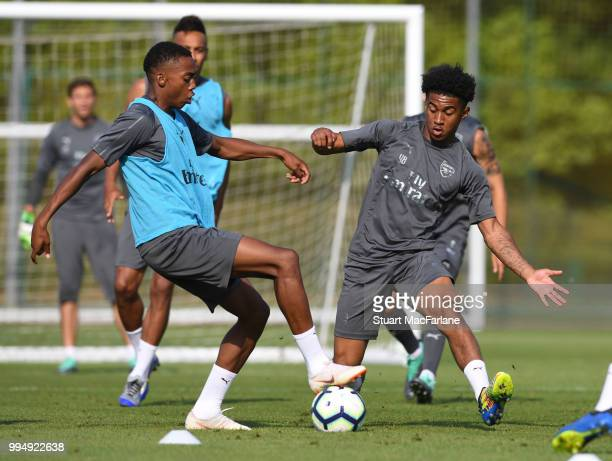 Joe Willock and Reiss Nelson of Arsenal compete for the ball during a training session at London Colney on July 9 2018 in St Albans England