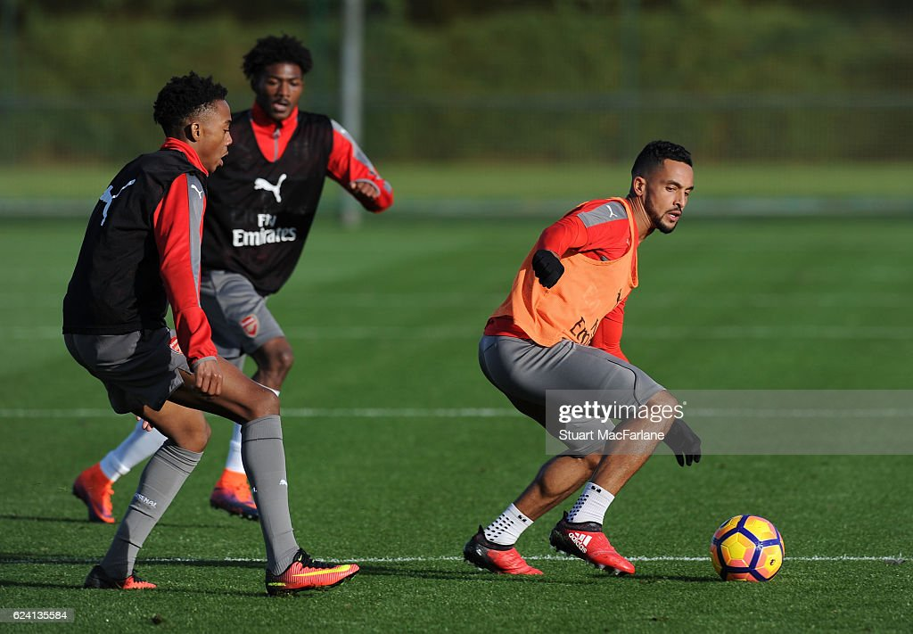 Joe Willock and Theo Walcott of Arsenal during a training session at London Colney on November 18, 2016 in St Albans, England.