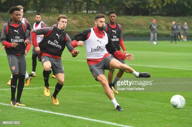Joe Willock Ben Sheaf and Olivier Giroud of Arsenal during a training session at London Colney on October 23 2017 in St Albans England