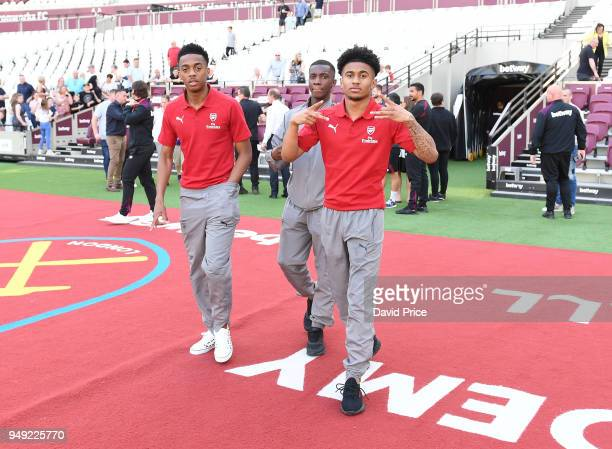 Joe Willock Eddie Nketiah and Reiss Nelson of Arsenal before the match between West Ham United and Arsenal at London Stadium on April 20 2018 in...