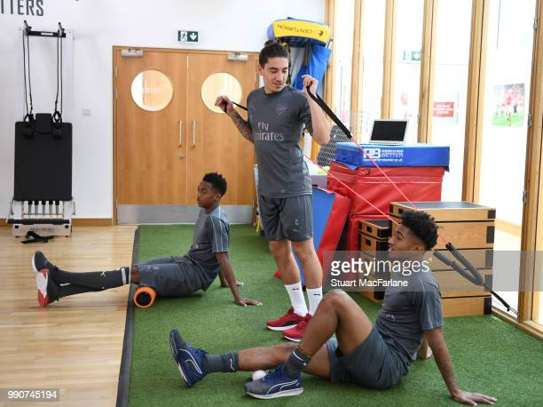 Joe Willock Hector Bellerin and Reiss Nelson of Arsenal during a training session at London Colney on July 3 2018 in St Albans England