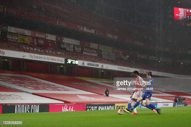 Joe Willock of Arsenal and Caglar Soyuncu of Leicester City inside an empty Emirates Stadium during the Premier League match between Arsenal FC and...