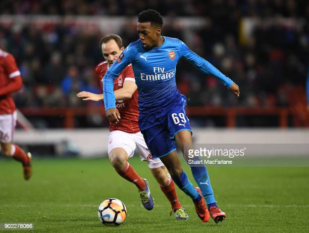 Joe Willock of Arsenal breaks past David Vaughan of Nottingham Forest during the FA Cup 3rd Round match between Nottingham Forest and Arsenal at City...