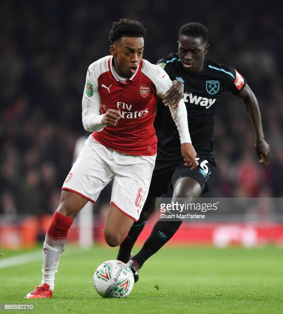 Joe Willock of Arsenal breaks past Domingos Quina of West Ham during the Carabao Cup Quarter Final match between Arsenal and West Ham United at...