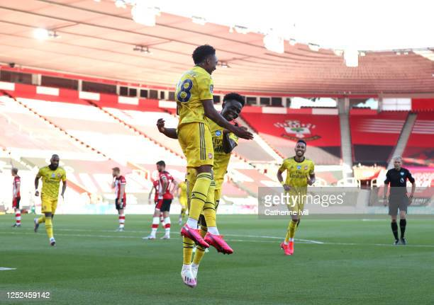 Joe Willock of Arsenal celebrates after scoring his sides second goal with teammate Bukayo Saka during the Premier League match between Southampton...