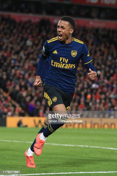 Joe Willock of Arsenal celebrates after scoring their 5th goal during the Carabao Cup Round of 16 match between Liverpool and Arsenal at Anfield on...