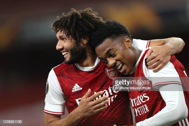 Joe Willock of Arsenal celebrates scoring their 2nd goal with Mohamed Elneny during the UEFA Europa League Group B stage match between Arsenal FC and...