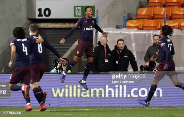 Joe Willock of Arsenal celebrates with teammates after scoring his team's first goal during the FA Cup Third Round match between Blackpool and...