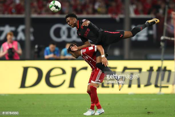 Joe Willock of Arsenal FC of Arsenal FC competes for the ball with Juan Bernat of FC Bayern during the 2017 International Champions Cup football...