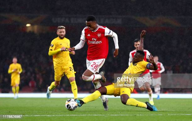 Joe Willock of Arsenal is challenged by Jean-Francois Gillet of Standard Liege during the UEFA Europa League group F match between Arsenal FC and...