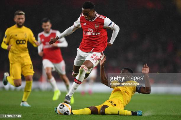 Joe Willock of Arsenal is fouled by PaulJose M'Poku of Standard Liege during the UEFA Europa League Group F match between Arsenal FC and Standard...