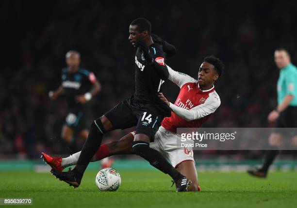 Joe Willock of Arsenal tackles Pedro Obiang of West Ham during the Carabao Cup Quarter Final match between Arsenal and West Ham United at Emirates...