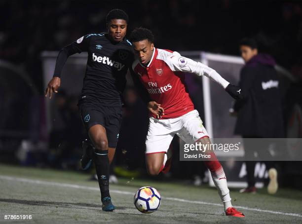 Joe Willock of Arsenal takes on Ben Johnson of West Ham during the Premier League Two match between Arsenal U23 and West Ham United U23 at Meadow...