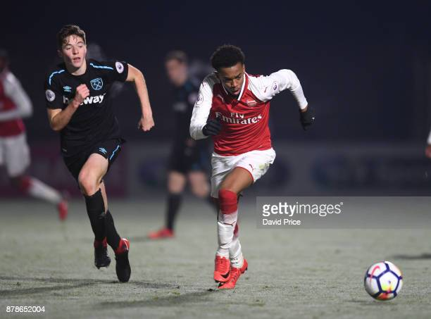 Joe Willock of Arsenal takes on Conor Coventry of West Ham during the Premier League Two match between Arsenal U23 and West Ham United U23 at Meadow...