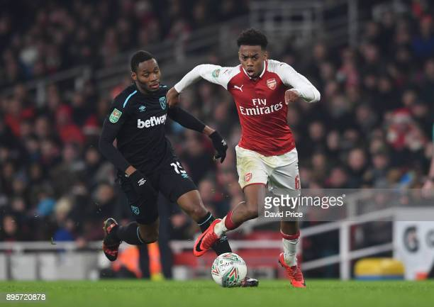 Joe Willock of Arsenal takes on Diafra Sakho of West Ham during the Carabao Cup Quarter Final match between Arsenal and West Ham United at Emirates...