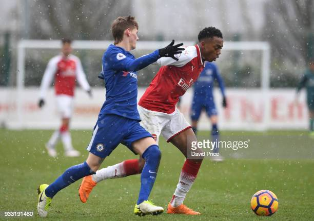 Joe Willock of Arsenal takes on Kyle Scott of Chelsea during the match between Arsenal U23 and Chelsea U23 at London Colney on March 17 2018 in St...