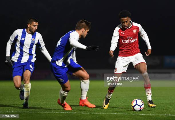 Joe Willock of Arsenal takes on Luiz Palhares of Porto during the match between Arsenal U23 and Porto at Meadow Park on November 17 2017 in...