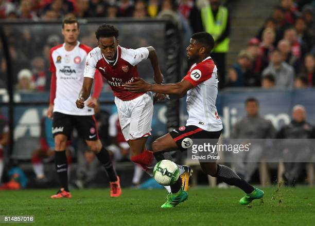 Joe Willock of Arsenal takes on Roly Bonevacia of Western Sydney during the match between the Western Sydney Wanderers and Arsenal FC at ANZ Stadium...
