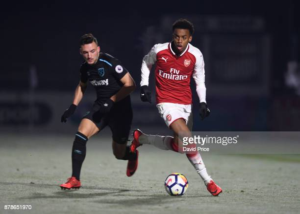 Joe Willock of Arsenal takes on Sead Haksabanovic of West Ham during the Premier League Two match between Arsenal U23 and West Ham United U23 at...