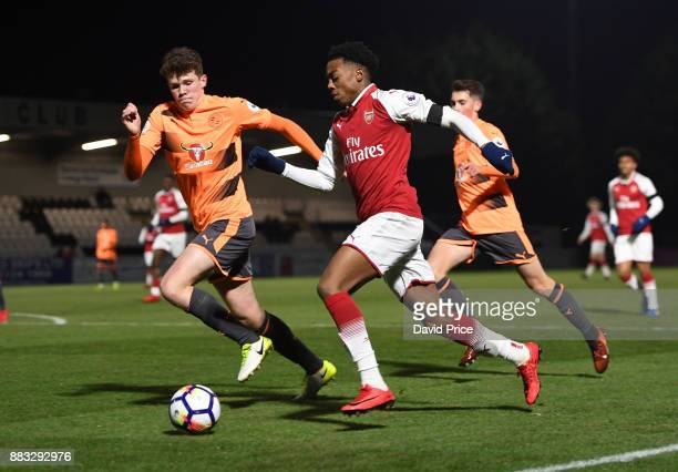 Joe Willock of Arsenal takes on Tom Holmes of Reading during the Premier League International Cup match between Arsenal and Reading at Meadow Park on...
