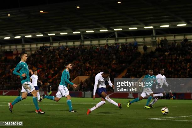 Joe Willock of England scores his team's first goal during the international friendly match between England U20 and Germany U20 at Colchester...
