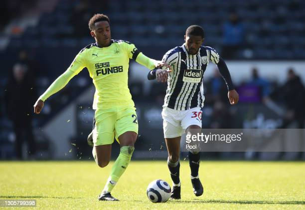 Joe Willock of Newcastle United and Ainsley Maitland-Niles of West Bromwich Albion battle for possession during the Premier League match between West...