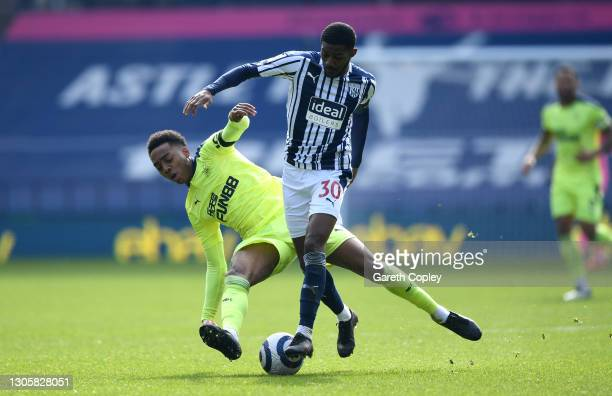 Joe Willock of Newcastle United battles for possession with Ainsley Maitland-Niles of West Bromwich Albion during the Premier League match between...
