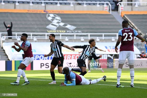 Joe Willock of Newcastle United celebrates after scoring his team's third goal during the Premier League match between Newcastle United and West Ham...