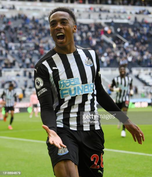 Joe Willock of Newcastle United celebrates after scoring his team's first goal during the Premier League match between Newcastle United and Sheffield...
