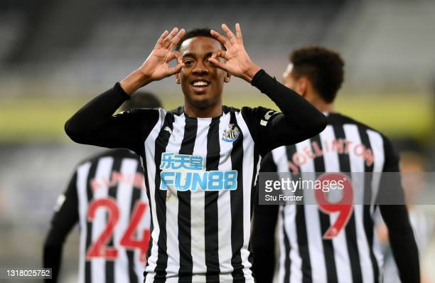Joe Willock of Newcastle United celebrates after scoring their side's third goal during the Premier League match between Newcastle United and...