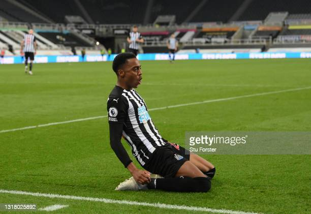 Joe Willock of Newcastle United celebrates after scoring their sides third goal, missing from the penalty spot but scoring the rebound during the...