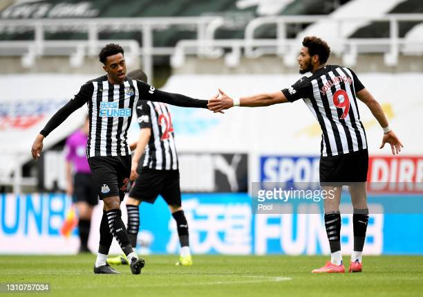 Joe Willock of Newcastle United celebrates with teammate Joelinton after scoring their team's second goal during the Premier League match between...