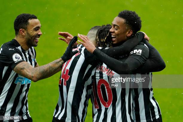 Joe Willock of Newcastle United celebrates with teammates Callum Wilson, Miguel Almiron and Allan Saint-Maximin after scoring his team's first goal...