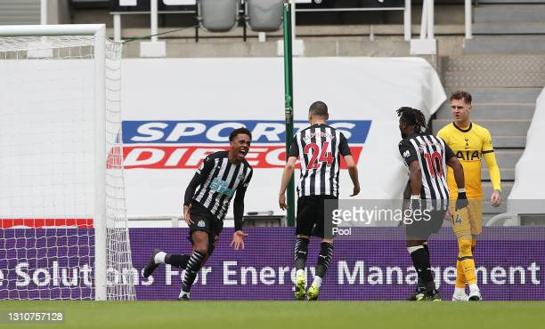 Joe Willock of Newcastle United celebrates with teammates Miguel Almiron and Allan Saint-Maximin after scoring his team's second goal during the...