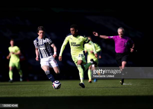 Joe Willock of Newcastle United is tackled by Conor Gallagher of West Bromwich Albion during the Premier League match between West Bromwich Albion...