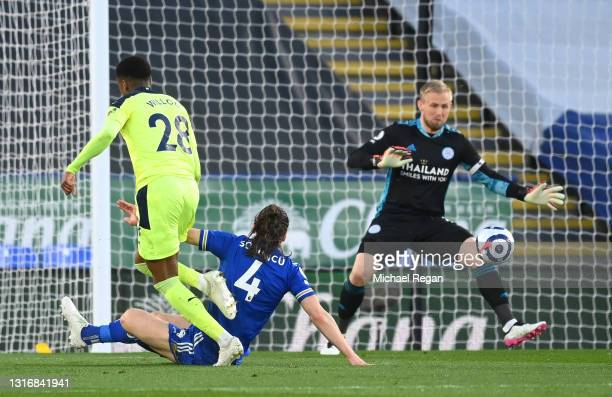 Joe Willock of Newcastle United scores his team's first goal past Kasper Schmeichel of Leicester City during the Premier League match between...