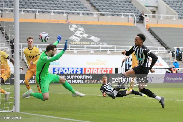Joe Willock of Newcastle United scores their 2nd goal past Tottenham Hotspur goalkeeper Hugo Lloris during the Premier League match between Newcastle...