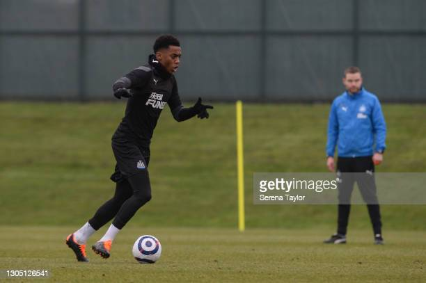 Joe Willock runs with the ball during the Newcastle United Training Session at the Newcastle United Training Centre on March 03, 2021 in Newcastle...