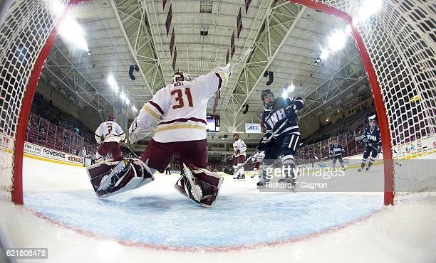 Joe Woll of the Boston College Eagles makes a shoulder save against the New Hampshire Wildcats during NCAA hockey at Kelley Rink on November 8 2016...