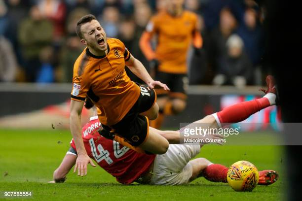 Joe Worrall of Nottingham Forest fouls Diogo Jota of Wolverhampton Wanderers during the Sky Bet Championship match between Wolverhampton and...
