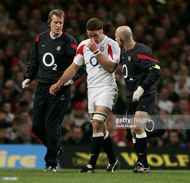 Joe Worsley of England leaves the field early in the first half with concussion during the RBS Six Nations Championship match between Wales and...
