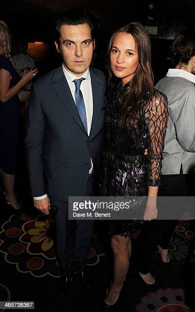 Joe Wright and Alicia Vikander attend the Charles Finch and Chanel PreBAFTA cocktail party and dinner at Annabel's on February 8 2013 in London...