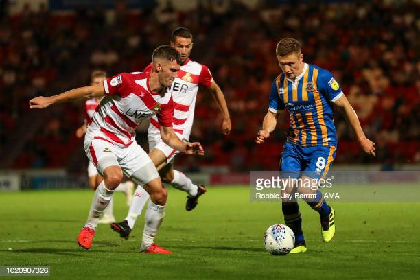 Joe Wright of Doncaster Rovers and Greg Docherty of Shrewsbury Town during the Sky Bet League One match between Doncaster Rovers and Shrewsbury Town...