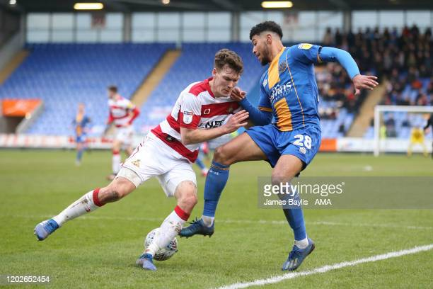 Joe Wright of Doncaster Rovers and Josh Laurent of Shrewsbury Town during the Sky Bet League One match between Shrewsbury Town and Doncaster Rovers...