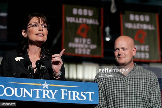 Joe Wurzelbacher looks on as Republican vicepresidential nominee Alaska Gov Sarah Palin speaks October 29 2008 at Bowling Green University in Bowling...