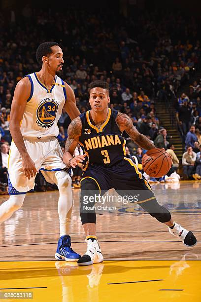 Joe Young of the Indiana Pacers dribbles the ball against the Golden State Warriors on December 5 2016 at ORACLE Arena in Oakland California NOTE TO...