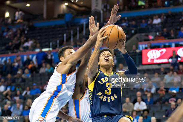 Joe Young of the Indiana Pacers drives to the basket during a game against the Oklahoma City Thunder at the Chesapeake Energy Arena on October 25,...
