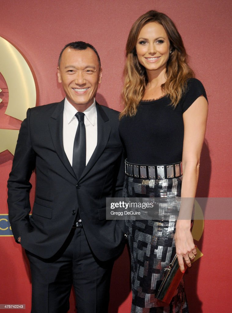 Joe Zee and actress Stacy Keibler arrive at the QVC 5th Annual Red Carpet Style event at The Four Seasons Hotel on February 28, 2014 in Beverly Hills, California.