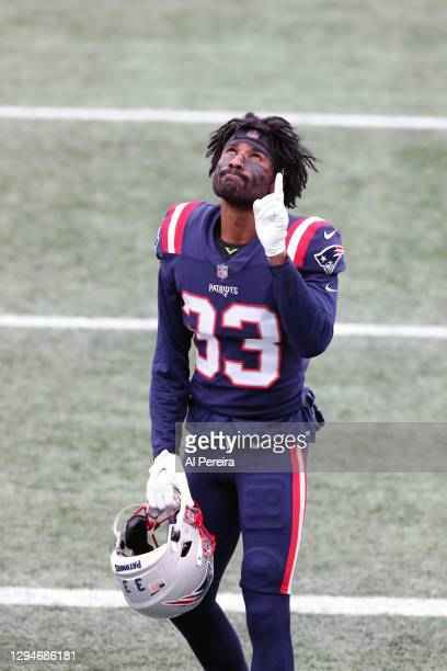 Joejuan Williams of the New England Patriots points to the heavens before the game against the New York Jets at Gillette Stadium on January 3, 2021...