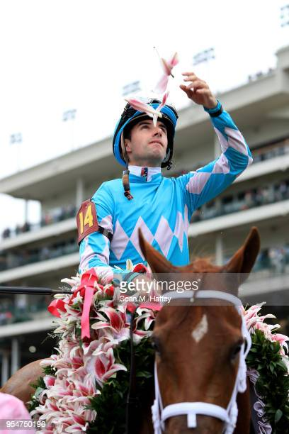 Joekey Florent Geroux celebrates atop of Monomoy Girl after winning the 144th running of the Kentucky Oaks at Churchill Downs on May 4 2018 in...